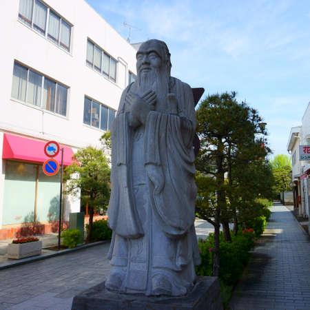 ASHIKAGA, TOCHIGI / JAPAN – Aprel 29, 2019: A stone statue to Confucius at the entrance of the path to Ashikaga Gakko is Japan's oldest academic institution