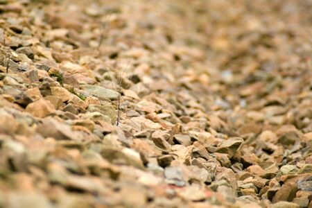 overburden: brown stones lying on the slope of the overburden rail Stock Photo