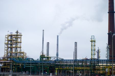 chemical plants polluting the air with large chimneys photo