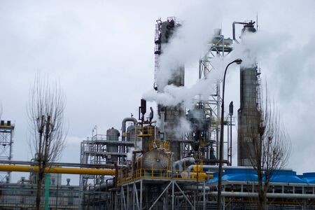 chemical plants polluting the air with large chimneys