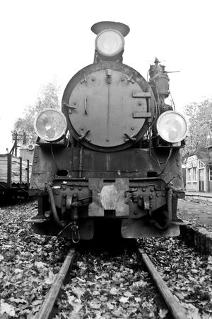 railway history: part of old steam train in black and white Stock Photo