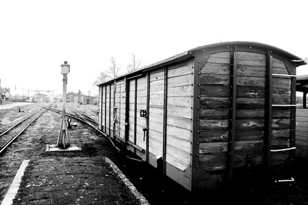 part of old steam train in black and white photo
