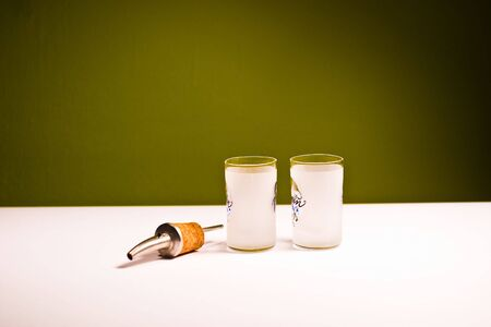 glass vessels standing on the white table, isolated background photo