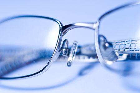 spec: stylish glasses lying on a white background, macro Stock Photo