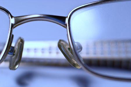 stylish glasses lying on a white background, macro photo