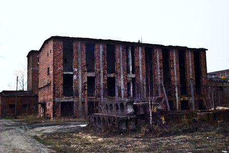 abandoned warehouse: Ruins of a very heavily polluted industrial site, 1890s the place was known as one of the most polluted towns in Europe.   Stock Photo