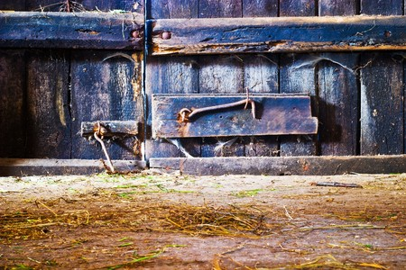 very old antique colored door of the building photo