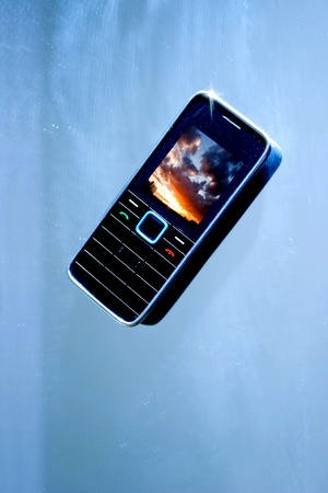 Modern Cell phone isolated on color background photo