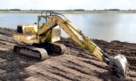 digger, Heavy Duty construction equipment parked at work site Stock Photo - 9491189