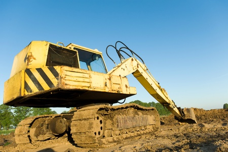 digger, Heavy Duty construction equipment parked at work site Stock Photo - 9724575