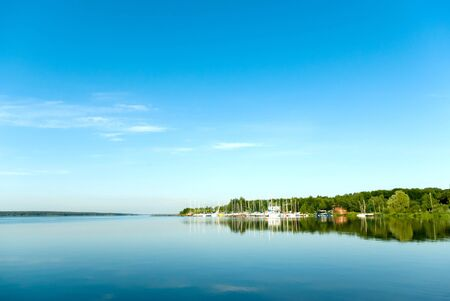 A rural blue lake and a green forest Stock Photo - 9725442