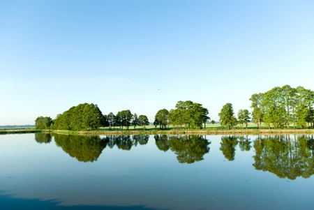 A rural small lake and a green forest Stock Photo - 9725912