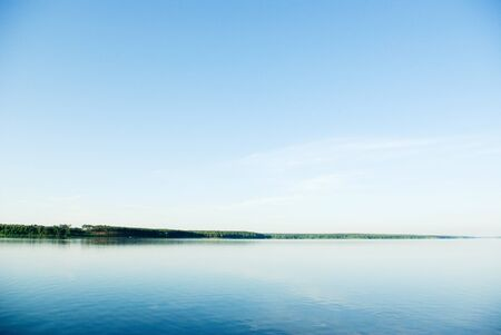 A rural blue lake and a green forest Stock Photo - 9725447