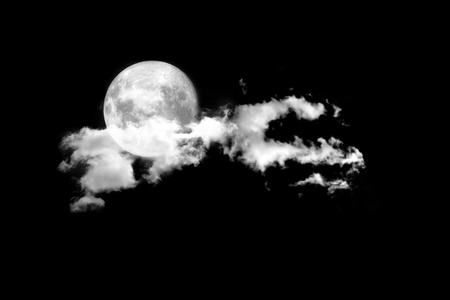brings: Moon between the clouds in dark nght, a dark night brings a bright, amber moon alive with puffy hazy clouds.