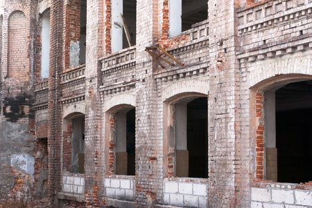 Discarded ruin with old windows and wall, industrial window in concrete wall Stock Photo - 12310440