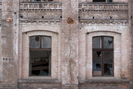 Discarded ruin with old windows and wall, industrial window in concrete wall Stock Photo - 12310418