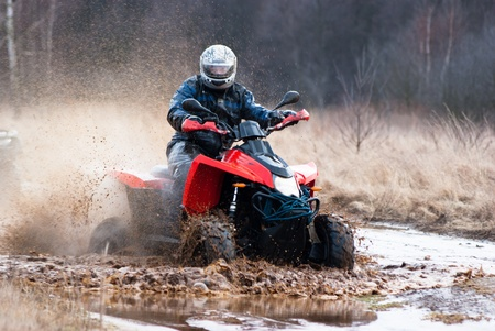 male riding a quad, four wheeler in rural, sport series Reklamní fotografie - 12563921