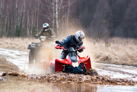 male riding a quad, four wheeler in rural, sport series