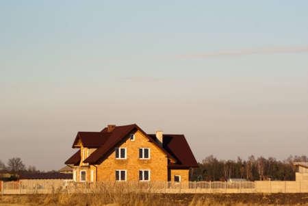 family home with garage, family house over blue sky, hauses series