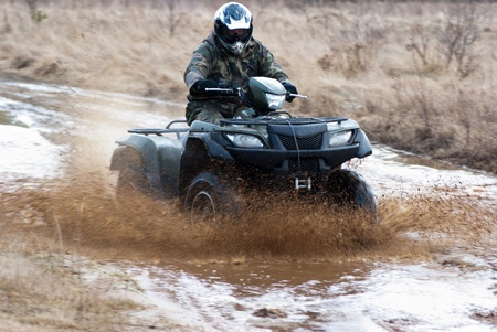 male riding a quad, four wheeler in rural, sport series photo