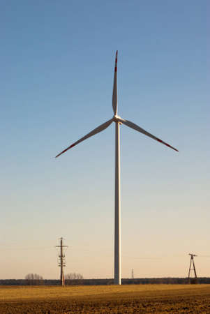 Wind turbines on green field. Alternative source of energy photo