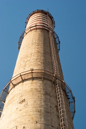 industry chimney in a blue sky on sunny day