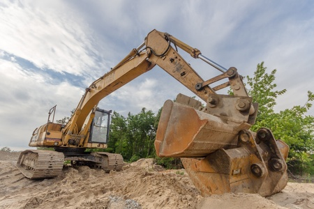 digger, heavy duty construction equipment parked at work site Stock Photo - 14340686