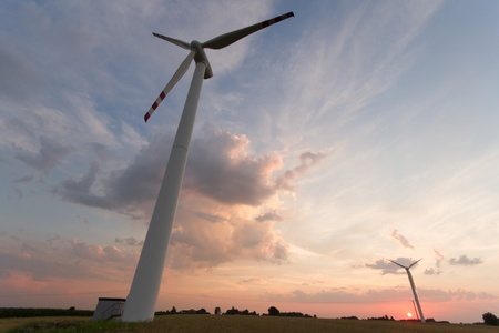Wind turbines on green field. Alternative source of energy photo