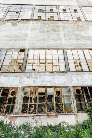 wide angle view of an old wall abandoned factory building