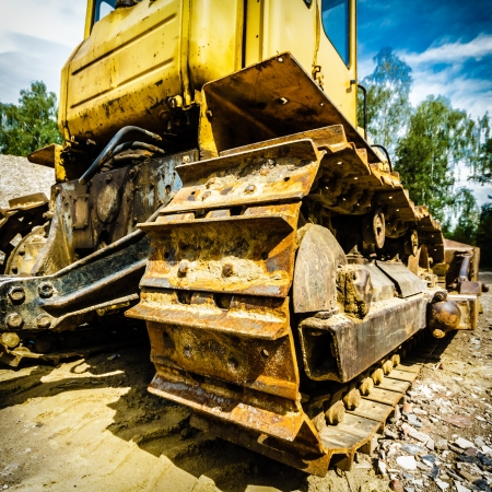 digger, heavy duty construction equipment parked at work site Stock Photo