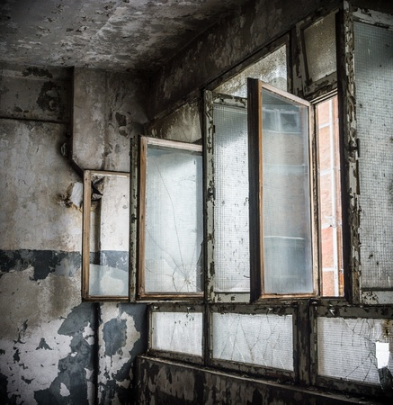 discarded ruin with old windows and wall, industrial window in concrete wall Stock Photo - 20952936