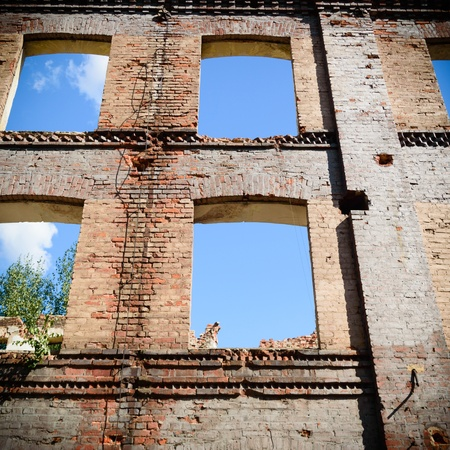discarded ruin with old windows and wall, industrial window in concrete wall photo
