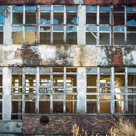 old windows: discarded ruin with old windows and wall