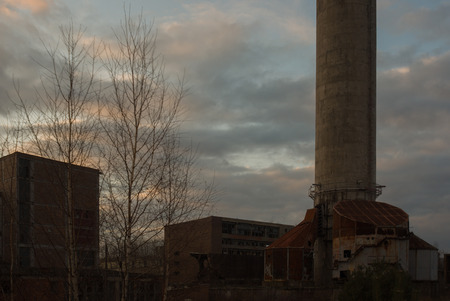 heavily: ruins of a very heavily polluted industrial factory, place was known as one of the most polluted towns in Europe Stock Photo