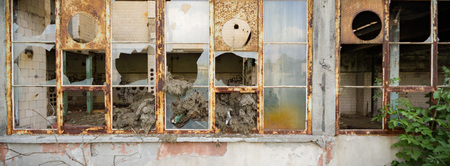 discarded: discarded ruin with old windows and wall, industrial window in concrete wall
