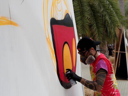 PATTAYA, THAILAND - FEBRUARY 3, 2017: A street artist doing street art