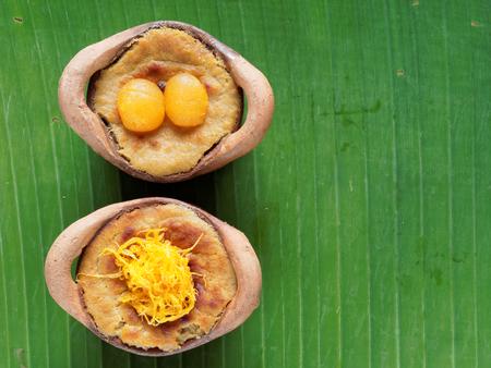 Thai coconut custard pudding dessert, Maw Gaeng, in clay pot on banana leaf background