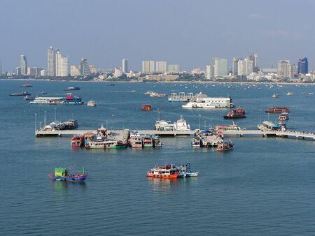 Pattaya scenery with tourists transit onto ferry at Bali Hai pier