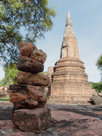 Stack of old ruin red brick in Phra Ram temple, archaeological or historic site, or ancient remains, famous tourist destination in Ayutthaya, Thailand with concepts of zen, meditation, and relaxation Stock Photo