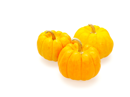 Three orange pumpkins in Big, medium, and small size isolated on white background show colorful pattern and scale used in Halloween, still life, kitchen, and comparison themes