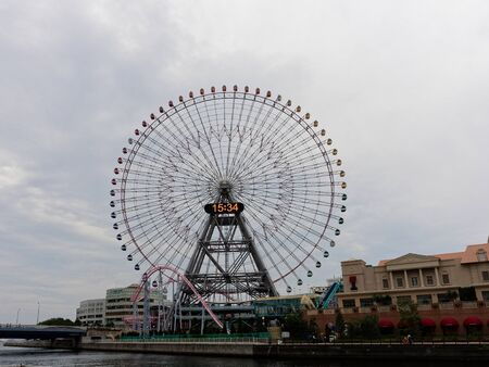 YOKOHAMA, JAPAN - SEPTEMBER 27, 2017 : Cosmo Clock 21, a giant Ferris wheel at the Cosmo World amusement park, is one of the main tourist attractions in Yokohama, Japan