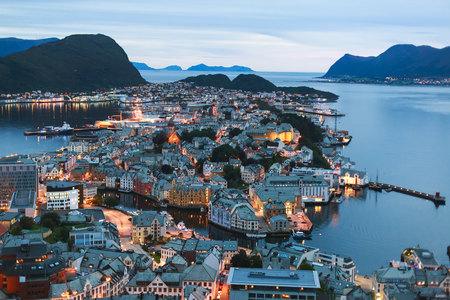 Beautiful super wide-angle summer aerial view of Alesund, Norway, with skyline and scenery beyond the city, seen from the observation deck of Aksla mountain Stock Photo