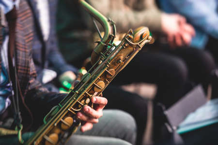 Concert view of a saxophonist, saxophone sax player with vocalist and musical during jazz orchestra performing music on stage Stock fotó