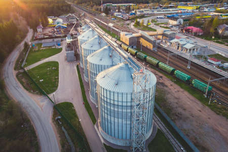 Aerial top view of Grain Elevator Silos, Granary of a feed mill built of modern metal structures, drone shot