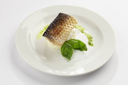 Mullet with mashed potatoes, basil and poached egg photo