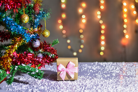 Gift Box in christmas day with christmas tree and Blur light Background.