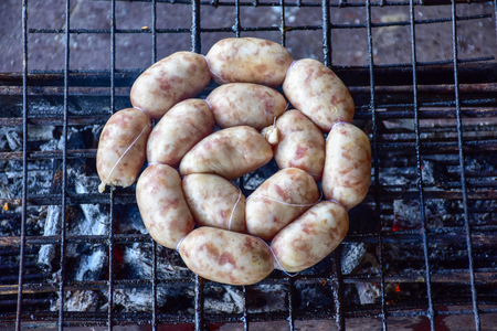 Grilled sausages on charcoal stove thai foods.