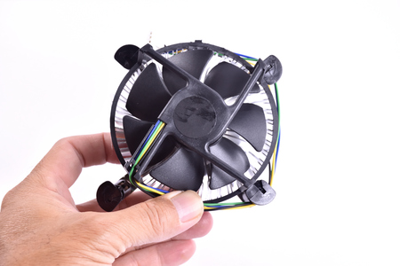 CPU fan and heat sink for computer in hand on white background.