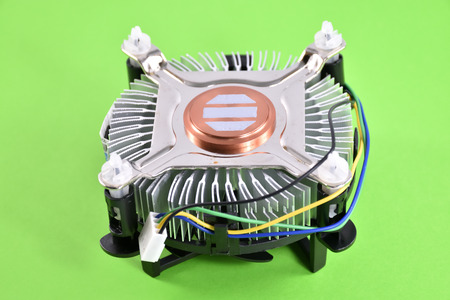 CPU fan for computers on green background.
