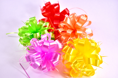 Gift ribbon many colors on white background.